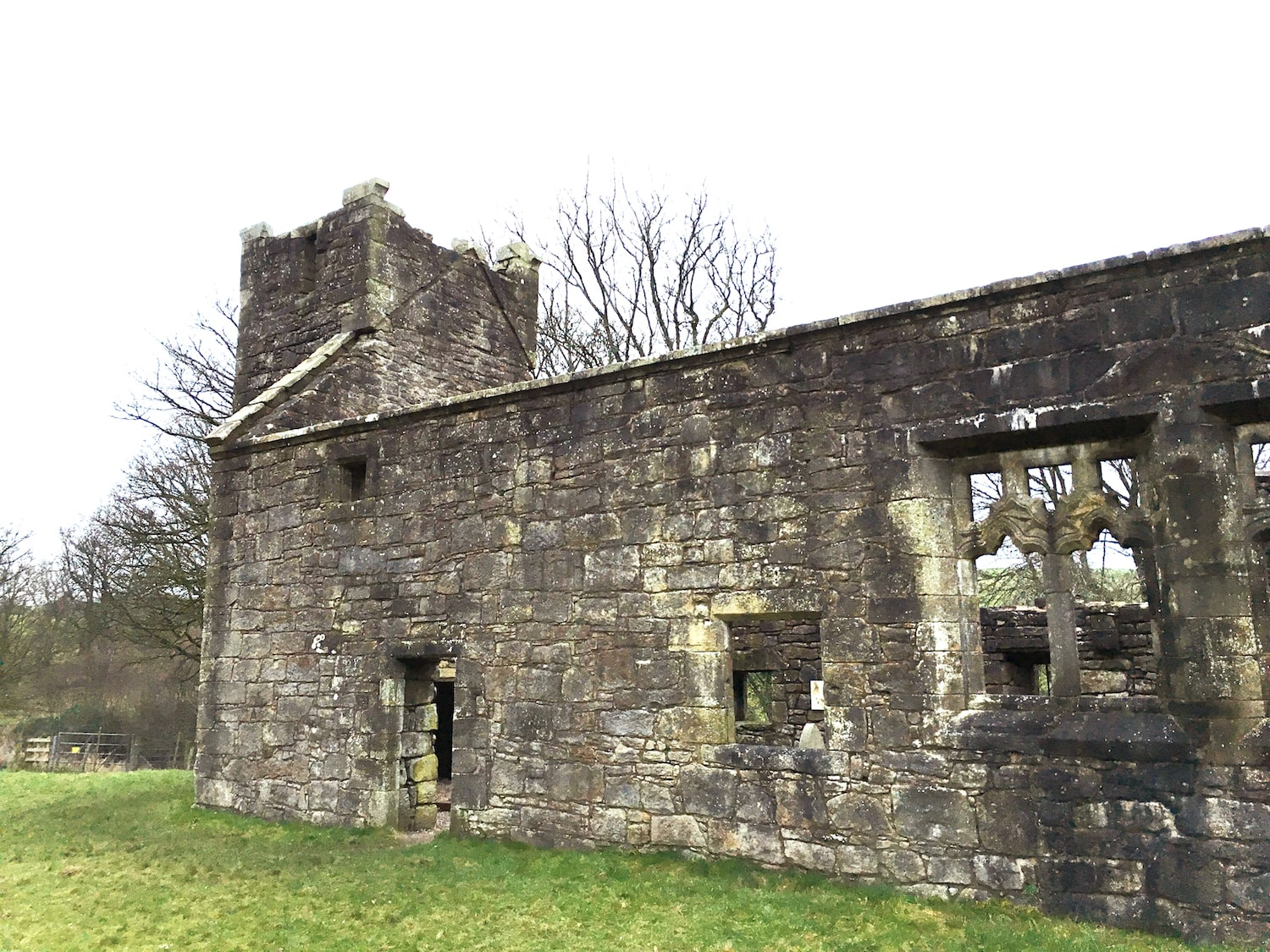 The roofless surviving structure of Castle Semple Collegiate Church